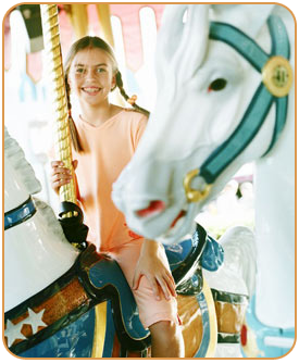 child on a carousel